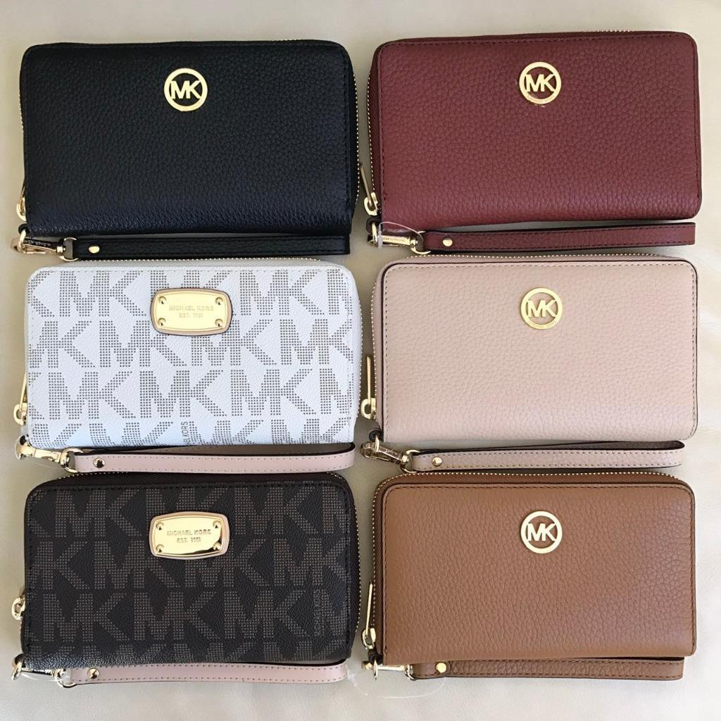 Read more about the article NEW Michael Kors Jet Set Zip Around Phone Case Wallet Wristlet Various Colors